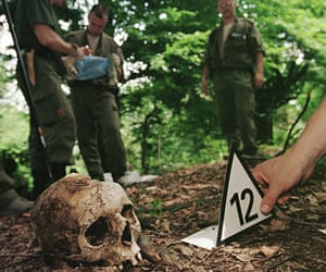 Ratko Mladic: A forensic expert places a number next to the skull of a Srebrenica victim