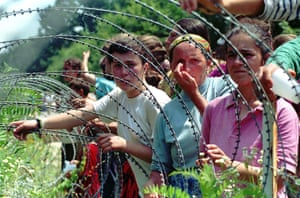 Ratko Mladic: Refugees from Srebrenica looking through the razorwire at arriving refugees