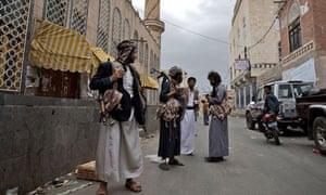 Armed tribesmen guard the home of Hashid leader Sheikh Sadeq al-Ahmar