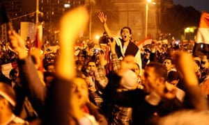Egyptians celebrate the resignation of Hosni Mubarak in Tahrir Square