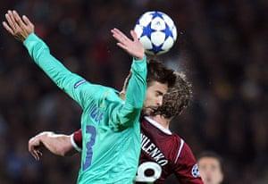 Barcelona: Gerard Pique (L) of FC Barcelona vies wi
