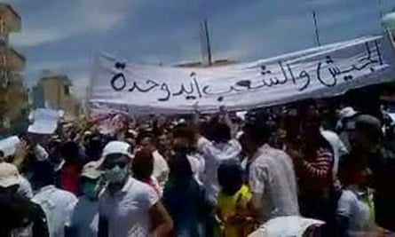 Pro-democracy demonstrators in Syria as seen in a YouTube video