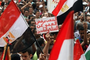 Middle East Unrest: An Egyptian protester holds a sign