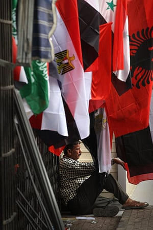 Middle East Unrest: A flag seller sits in Tahrir Square