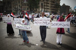 Middle East Unrest: A man and his family hold placards