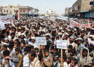 Middle East Unrest: Residents of a northern Yemeni province hold placards