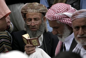 Middle East Unrest: A Yemeni anti-regime protester reads from Islam's holy book