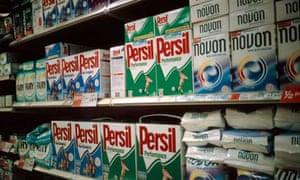 Packets of detergent on supermarket shelves