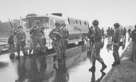 Freedom Riders surrounded by National Guardsmen in 1961.