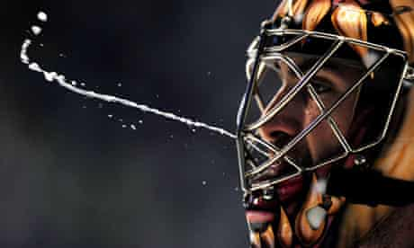 Hockey World Championship goalkeeper spits during a match