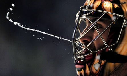 Hockey World Championship goalkeeper spits during a match