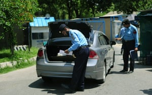 Pakistan : Policemen search a vehicle entering the diplomatic enclave in Islamabad