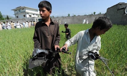 Boys in Abbottabad with Osama bin Laden's compound in the background