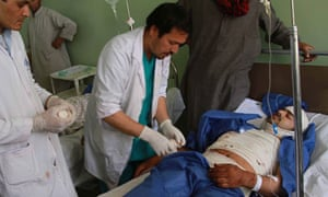 Doctors help the injured in Herat