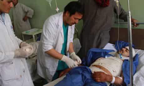 Doctors help the injured in Herat