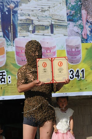 Bee suit: Zhang Wei holds his world record certificate in China