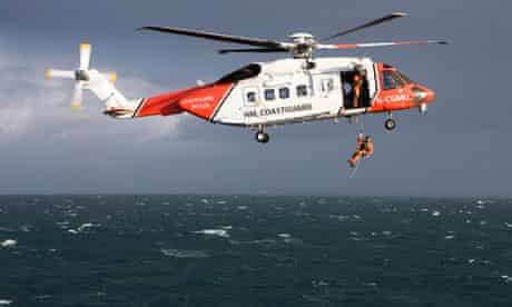 Coastguard helicopter over sea