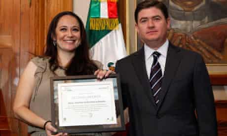 School teacher Martha Rivera Alanis receives certificate