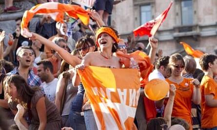 Italians celebrate in Milan after Silvio Berlusconi's coalition lost control of the city