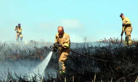 Firefighters battle a gorse fire