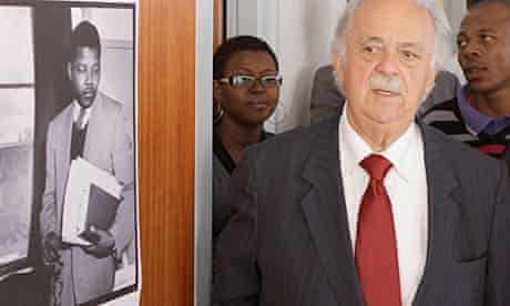 Nelson Mandela's lawyer, George Bizos, has a look at Mandela's room at the Chancellor House office