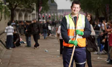 Lukasz Kulaga, a foreman with Veolia clears up outside Westminster Abbey after the Royal wedding