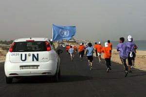 gaza marathon: A UN vehicle escorts Palestinian and foreign runners in Rafah