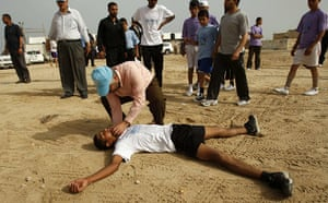 gaza marathon: A Palestinian runner is treated after fainting