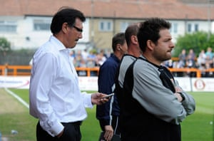 Barnet v Port Vale:  Barnet's managerial consultant Lawrie Sanchez checks scores on his phone