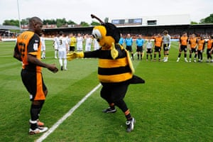 Barnet v Port Vale: Barnet's mascot, Mr Bumble, welcomes Izale McLeod onto the pitch