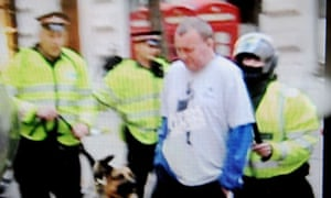 Ian Tomlinson being pushed by police officer