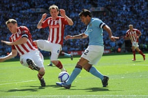 Top 50 transfer targets: Carlos Tevez crosses past Shawcross and Whelan during the FA Cup final