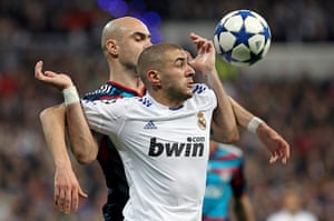 Top 50 transfer targets: Real Madrid's Karim Benzema & Lyon's Cristiano Marques fight for the ball