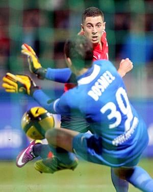 Top 50 transfer targets: Lille's Eden Hazard tries to score against Caen's goalkeeper Thomas Bosmel