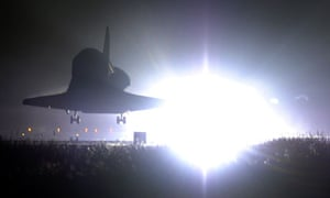 Space shuttle Endeavour silhouetted by landing lights as it touches down at Kennedy Space Centre after its own final mission and the second-last for the shuttle fleet. Photograph: Timothy A Clary/AFP/Getty Images