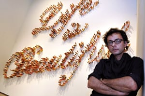 Venice biennale: Artist Fahrad Moshiri poses in front of his piece Life is beautif