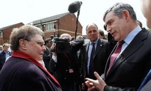 Britain's Prime Minister Gordon Brown speaks with resident Gillian Duffy