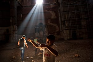 24 hours in pictures: Boy looks at a reel of film, Benghazi, Libya