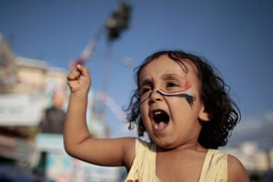 24 hours in pictures: A girl shouts during a rally in Sana'a, Yemen