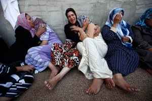 24 hours in pictures: Women mourn during a funeral in Misrata