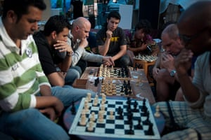 24 hours in pictures: Protesters play chess in Madrid's central Puerta del Sol square