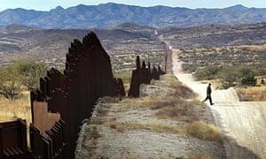 A US Border Patrol agent near the fence along Arizona's border with Mexico