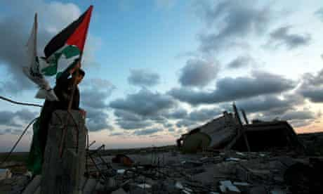 Palestinian children hold flag
