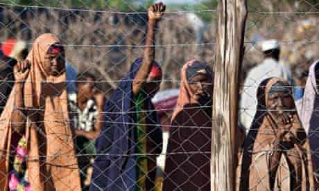 Somali refugees line up for food handouts at Dadaab