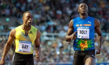 USA Tyson Gay (L) wins the men's 100 m