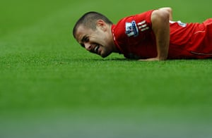 Unwanted players transfer: Liverpool's midfielder Joe Cole winces after a tackle