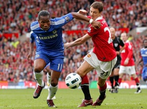 Unwanted players transfer: Manchester United's Jonny Evans challenges Chelsea's Didier Drogba