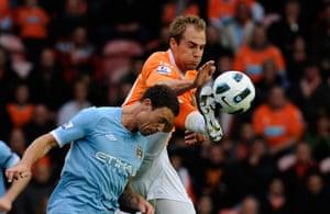 Unwanted players transfer: Blackpool's Luke Varney challenges Manchester City's Wayne Bridge