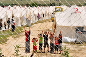 Syrian refugees: Syrian refugee children flash V-signs at the Boynuyogun Red Crescent camp