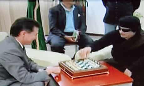 World Chess Federation chief meets Gaddafi for chess match